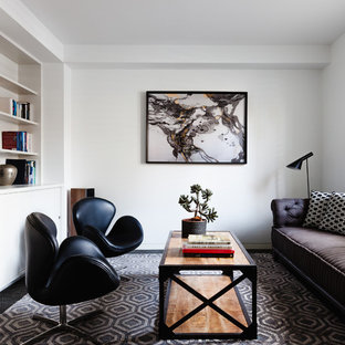 Living room library - small contemporary enclosed living room library idea in Melbourne with white walls and a media wall