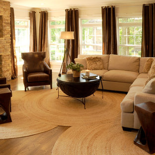 Living room - contemporary living room idea with a standard fireplace and a wall-mounted tv