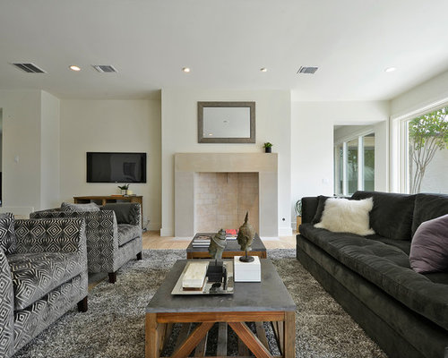 Inspiration For A Contemporary Living Room Remodel In Austin With Standard Fireplace And Wall