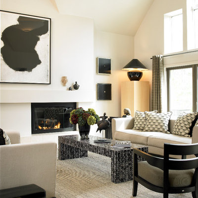 Inspiration for a mid-sized contemporary formal and open concept dark wood floor living room remodel in Boston with white walls, a standard fireplace, a plaster fireplace and no tv