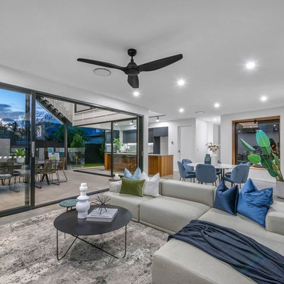 Example of a trendy open concept gray floor living room design in Brisbane with white walls