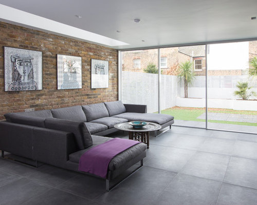 Example Of A Trendy Concrete Floor Living Room Design In London