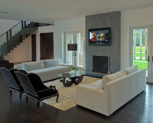 Trendy Living Room Photo In Other With A Standard Fireplace, A Wall Mounted  Tv