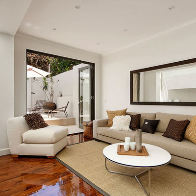 Example of a trendy living room design in Sydney with white walls