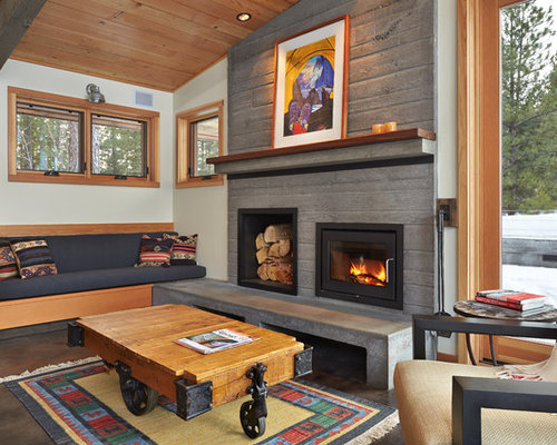 Example of a trendy concrete floor living room design in Seattle with a  standard fireplace