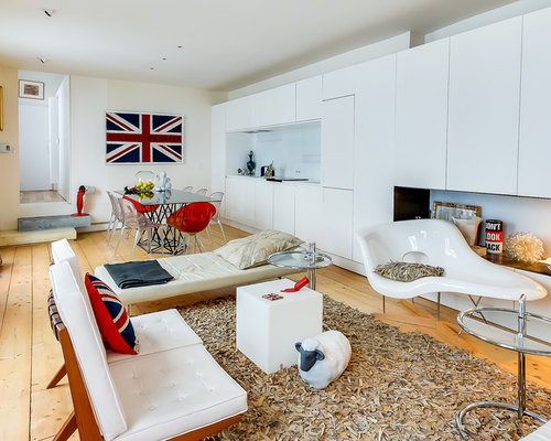 Trendy Enclosed Medium Tone Wood Floor Living Room Photo In London With  White Walls