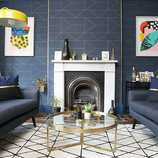 Design ideas for a contemporary formal living room in London with blue walls and a standard fireplace.