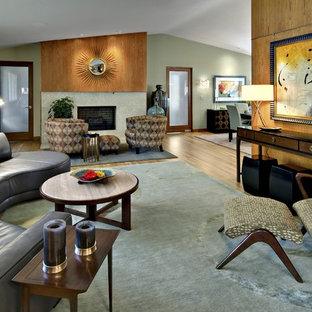 Foto de salón moderno con paredes verdes y chimenea tradicional