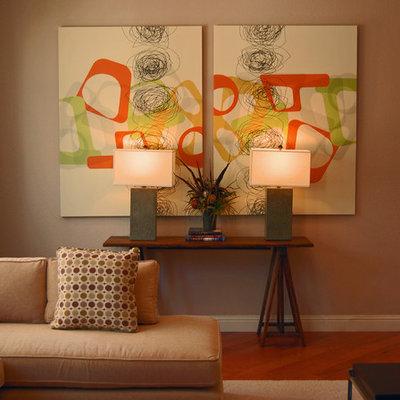 Trendy open concept medium tone wood floor living room photo in Sacramento with gray walls