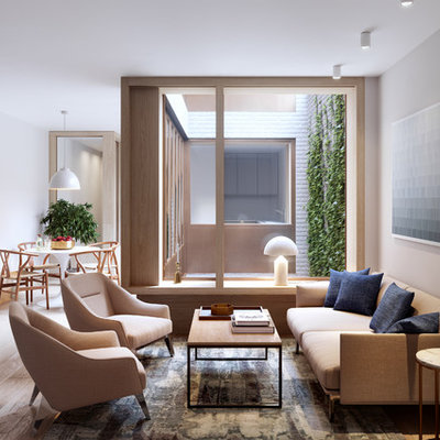 Living room - mid-sized contemporary enclosed light wood floor and beige floor living room idea in London with gray walls
