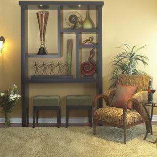 トロントの中くらいのコンテンポラリースタイルのおしゃれなLDK (黄色い壁、濃色無垢フローリング、標準型暖炉、石材の暖炉まわり、テレビなし) の写真