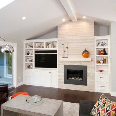 Living room - contemporary living room idea in San Francisco with a standard fireplace and a media wall