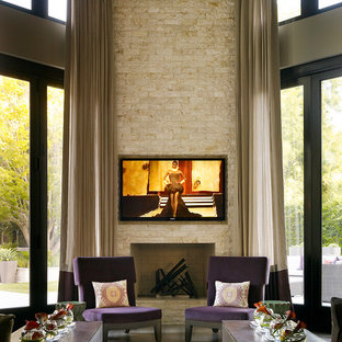 Photo of a contemporary living room in London with a standard fireplace and a wall mounted tv.