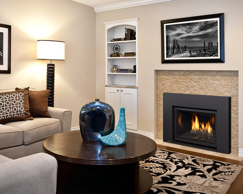 Trendy Living Room Photo In Vancouver With A Ribbon Fireplace And A Stone  Fireplace