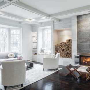 Inspiration for a large contemporary formal open plan living room in New York with dark hardwood flooring, a ribbon fireplace, white walls, a metal fireplace surround, no tv and brown floors.