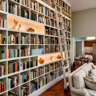 Inspiration for a contemporary medium tone wood floor living room library remodel in Burlington with green walls