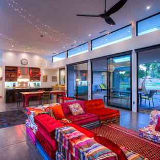 Example of a large trendy open concept concrete floor living room design in Phoenix with white walls