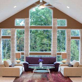 Example of a trendy beige floor living room design in San Diego with brown walls