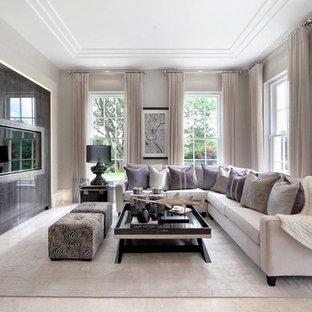 Ispirazione per un soggiorno contemporaneo di medie dimensioni con sala formale, pareti grigie e TV a parete