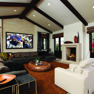 Example of a huge trendy living room design in Orange County with a wall-mounted tv