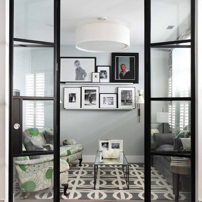 Example of a small trendy enclosed living room design in London with gray walls, no fireplace and no tv