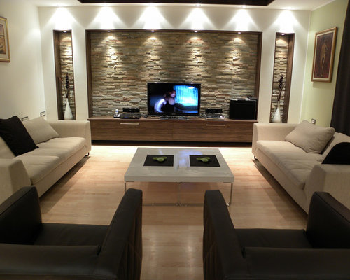 Contemporary Living Room Idea In Other With A Tv Stand And Beige Floors