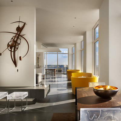 Inspiration for a contemporary open concept living room remodel in Philadelphia with white walls