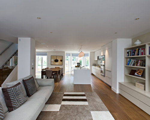 Example Of A Large Trendy Open Concept Medium Tone Wood Floor Living Room Design In London