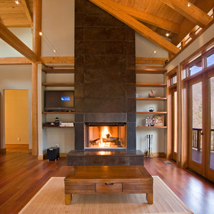 Living room - large craftsman open concept medium tone wood floor living room idea in Other with white walls, a standard fireplace, a stone fireplace and a media wall