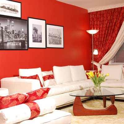 Example of a trendy living room design in New York with red walls