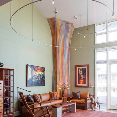 Eclectic formal living room photo in San Diego with green walls