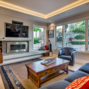 Trendy living room photo in San Francisco with a ribbon fireplace and a media wall