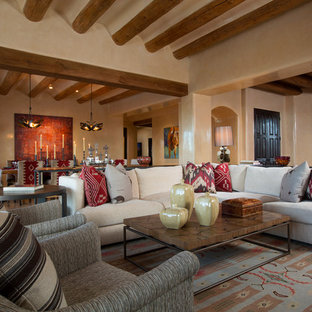 Inspiration for a mid-sized southwestern open concept living room remodel in Albuquerque with beige walls