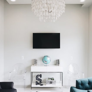 Photo of a small traditional formal living room in Houston with grey walls, vinyl flooring and a wall mounted tv.