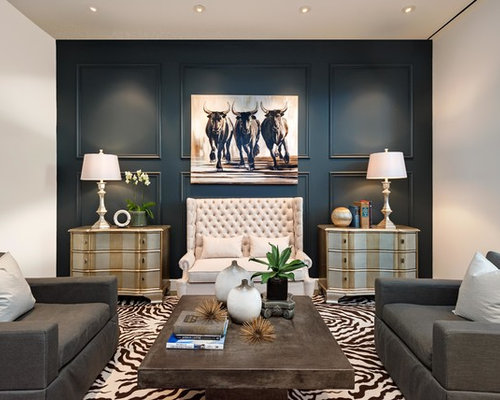 of a transitional formal living room design in phoenix with blue walls