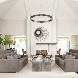 Inspiration för mycket stora moderna separata vardagsrum, med ett finrum, grå väggar, en dubbelsidig öppen spis, en spiselkrans i gips och mellanmörkt trägolv