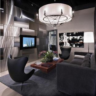 Ispirazione per un grande soggiorno minimal aperto con pareti grigie, nessun camino, TV a parete e parquet chiaro