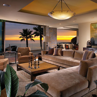 Inspiration for a large tropical living room remodel in Orange County with beige walls