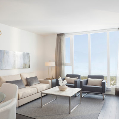 Example of a trendy living room design in Vancouver with white walls and a wall-mounted tv