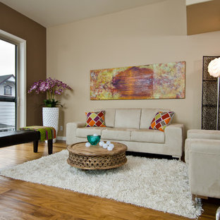Inspiration for a contemporary living room remodel in Portland with beige walls