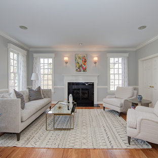 Example Of A Transitional Enclosed Medium Tone Wood Floor And Brown Floor  Living Room Design In