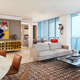 Example of a trendy open concept living room design in Miami with gray walls