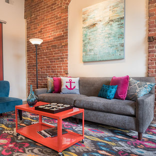 Example of an urban concrete floor living room design in Denver with red walls