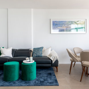 Design ideas for a beach style living room in Sydney with white walls and beige floor.