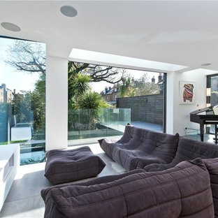 Photo of a large contemporary open plan living room in London with white walls, ceramic flooring, grey floors, a music area and a wall mounted tv.