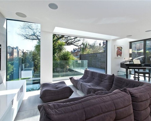Photo of a large contemporary open plan living room in london with white walls ceramic