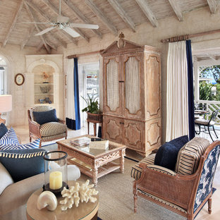 Island style enclosed living room photo in London
