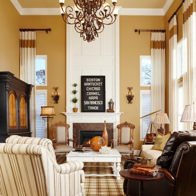 Example of a classic formal living room design in Detroit with yellow walls and a standard fireplace
