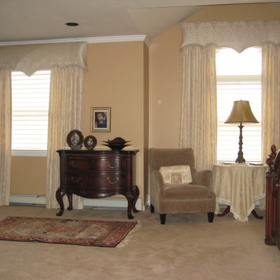 Example of a small classic open concept medium tone wood floor and brown floor living room design in New York with a music area, pink walls, no fireplace and no tv