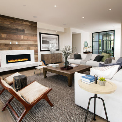 Inspiration for a contemporary formal and open concept medium tone wood floor living room remodel in Los Angeles with white walls and a ribbon fireplace